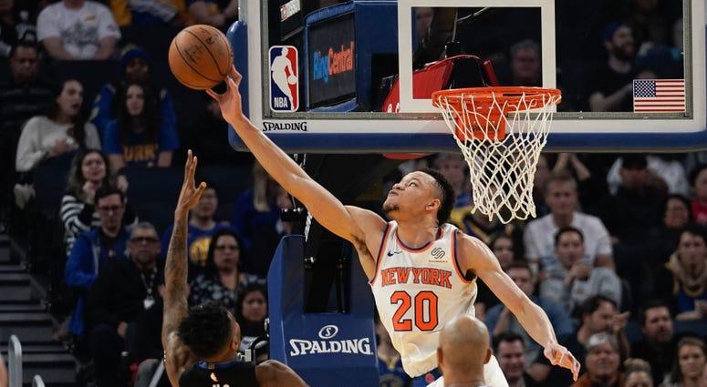 Knicks forward Kevin Knox II defends against Golden State Warriors guard Jacob Evans Dec 11, 2019; San Francisco, CA