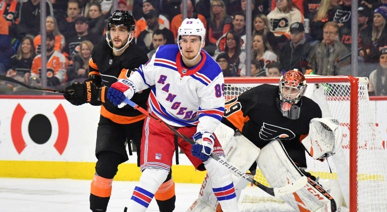 New York Rangers right wing Pavel Buchnevich (89) with Philadelphia Flyers defenseman Shayne Gostisbehere (53) in front of goaltender Carter Hart (79) during the first period on Dec 23, 2019 at Wells Fargo Center.
