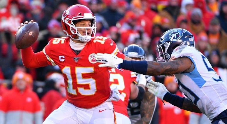 Chiefs quarterback Patrick Mahomes throws a pass against Tennessee Titans linebacker Derick Roberson Jan 19, 2020; Kansas City, Missouri