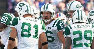 New York Jets guard Alan Faneca (66) and teammates in the huddle during the 1st quarter of a game against the Buffalo Bills on Nov 2, 2008 at Ralph Wilson Stadium. The New York Jets defeated the Buffalo Bills 26-17.