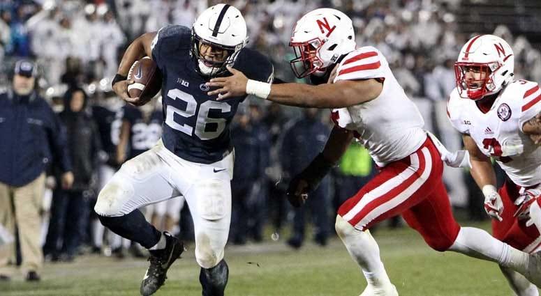 Penn State running back Saquon Barkley (26) runs the ball against Nebraska on Nov. 18, 2018, at Beaver Stadium in University Park, Pennsylvania.