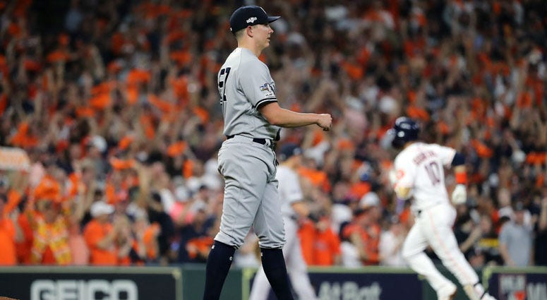 The Yankees' Chad Green reacts as Yuli Gurriel of the Houston Astros rounds the bases after hitting a three-run home run in Game 6 of the American League Championship Series on Oct. 19, 2019 in Houston.