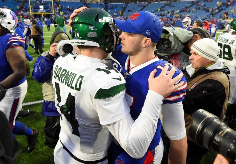 New York Jets quarterback Sam Darnold (14) and Buffalo Bills quarterback Josh Allen (17) meet following the game on Dec 29, 2019 at New Era Field.