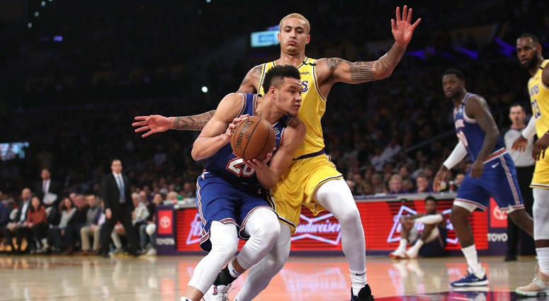 The Lakers' Kyle Kuzma defends against the Knicks' Kevin Knox on Jan. 7, 2020, at the Staples Center in Los Angeles.