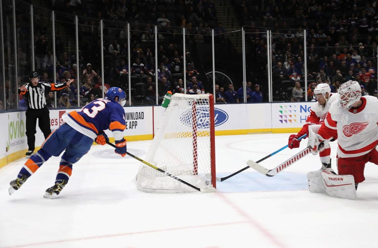 Madison Bowey of the Detroit Red Wings stops a shot by Mathew Barzal of the Islanders on the goal line during the second period at NYCB Live's Nassau Coliseum on January 14, 2020 in Uniondale, New York.