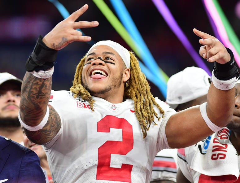 Ohio State defensive end Chase Young celebrates after the Buckeyes defeated the Wisconsin Badgers 34-21 in the 2019 Big Ten Championship Game at Lucas Oil Stadium on December 7, 2019.