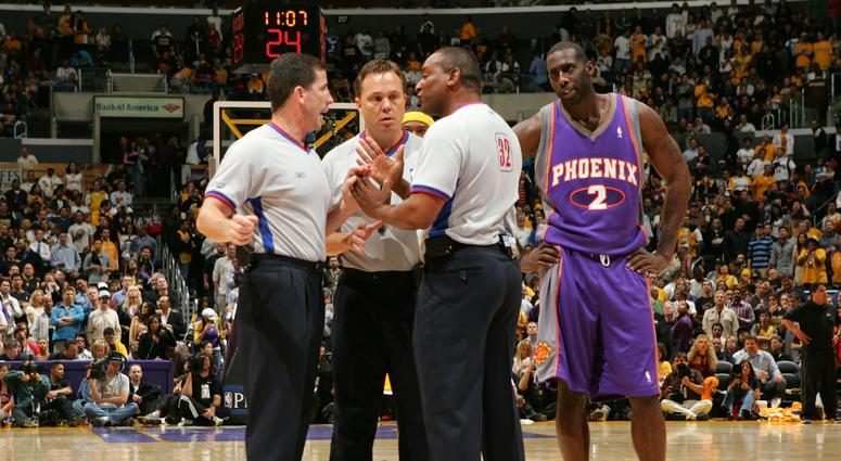 Los Angeles, CA - April 28, 2006: Tim Thomas of the Phoenix Suns looks in on as referees Tim Donaghy #21, Bill Spooner #22 and Eddie F. Rush discuss the proper call
