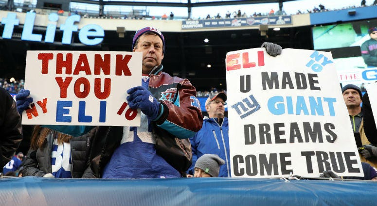 A New York Giants fan holds a sign for Eli Manning #10 of the New York Giants against the Miami Dolphins during their game at MetLife Stadium on December 15, 2019 in East Rutherford, New Jersey.