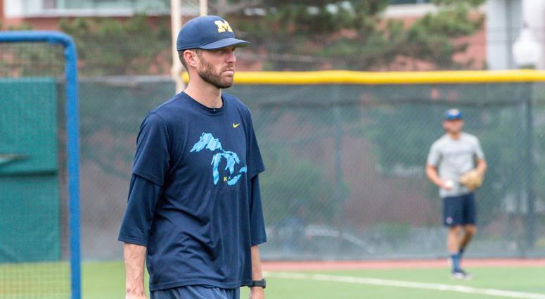 Michigan Wolverines pitching coach Chris Fetter looks on during team practice Jun 20, 2019; Omaha, NE