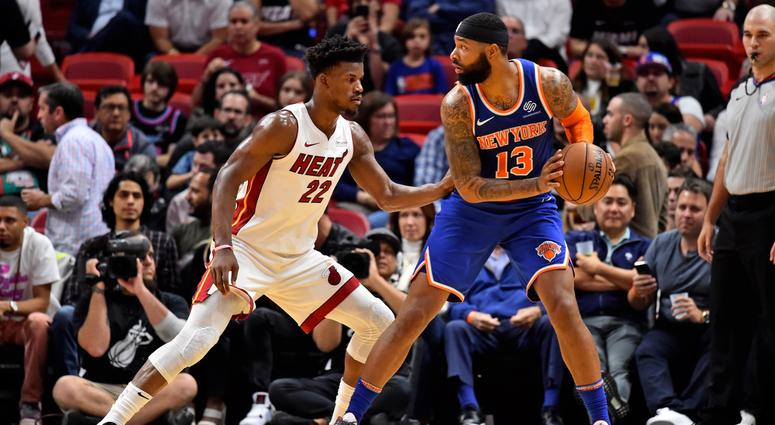Knicks forward Marcus Morris defended by Miami Heat forward Jimmy Butler Dec 20, 2019; Miami, Florida