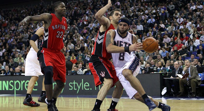 The Nets' Deron Williams runs past the Raptors defense at the O2 Arena in London on March 4, 2011.