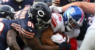 Saquon Barkley rushes the ball against Chicago Bears nose tackle Eddie Goldman during the second half at Soldier Field Nov 24, 2019; Chicago, IL