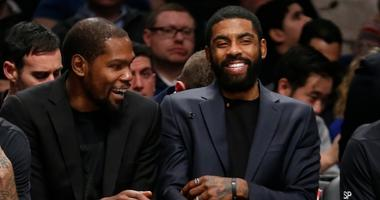 Brooklyn Nets forward Kevin Durant (7) and guard Kyrie Irving (11) react in the third quarter against the Oklahoma City Thunder on Jan 7, 2020 at Barclays Center.