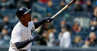 The Yankees' Miguel Andujar watches a sacrifice fly against the Baltimore Orioles on April 7, 2018, during the sixth inning at Yankee Stadium.