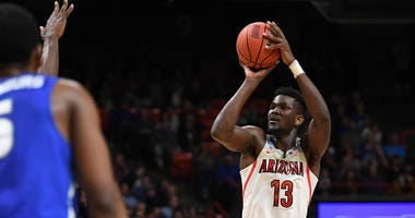 Arizona center DeAndre Ayton shoots against Buffalo in the NCAA tournament on March 15, 2018.