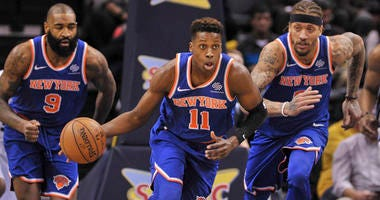 Knicks point guard Frank Ntilkina races up the court with the ball.