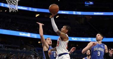 Knicks guard Trey Burke shoots over Orlando Magic forward Aaron Gordon on Feb. 22, 2018, Amway Center in Orlando, Florida.