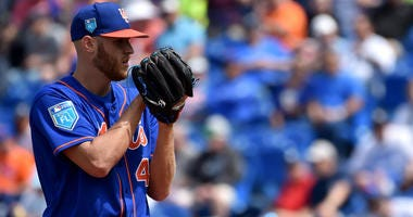The Mets' Zack Wheeler prepares to deliver a pitch against the Yankees during a spring training game on March 7, 2018, at First Data Field in Port St. Lucie, Florida.
