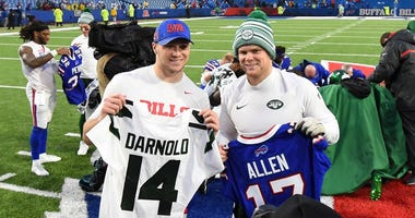 New York Jets quarterback Sam Darnold (right) and Buffalo Bills quarterback Josh Allen (left) pose for a photo after a jersey exchange following the game on Dec 29, 2019 at New Era Field.