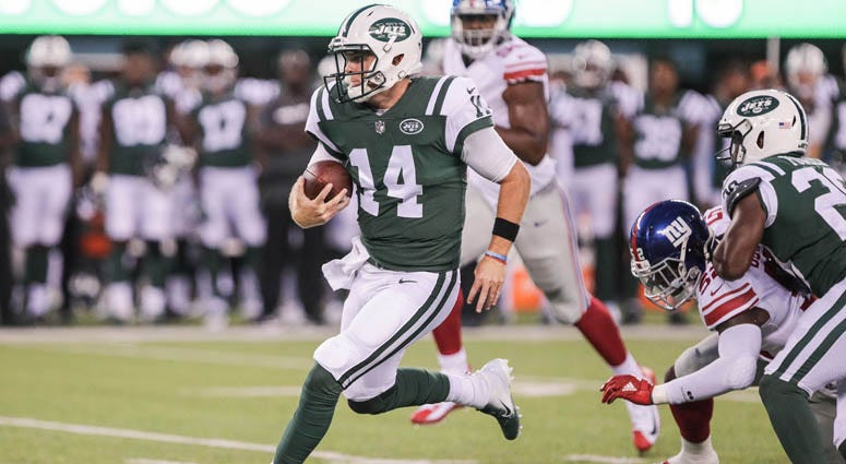 Jets quarterback Sam Darnold (14) rushes for yards during the first half against the New York Giants on Aug. 23, 2018, at MetLife Stadium.