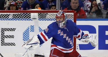 Igor Shesterkin stops the puck in net for the Rangers.