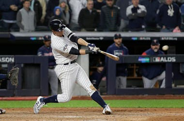 New York Yankees' DJ LeMahieu connects for a three-run double to left field against the Minnesota Twins during the seventh inning of Game 1 of an American League Division Series baseball game, Friday, Oct. 4, 2019, in New York