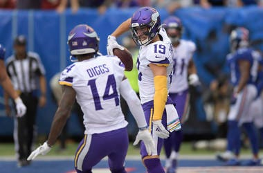 Minnesota Vikings wide receiver Adam Thielen (19) celebrates with wide receiver Stefon Diggs (14) after scoring a touchdown against the New York Giants during the second quarter of an NFL football game, Sunday, Oct. 6, 2019, in East Rutherford, N.J.