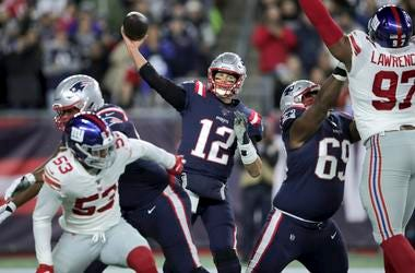 New England Patriots quarterback Tom Brady passes under pressure from the New York Giants in the first half of an NFL football game, Thursday, Oct. 10, 2019, in Foxborough, Mass.