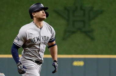 New York Yankees' Giancarlo Stanton hits a home run against the Houston Astros during the sixth inning in Game 1 of baseball's American League Championship Series Saturday, Oct. 12, 2019, in Houston.