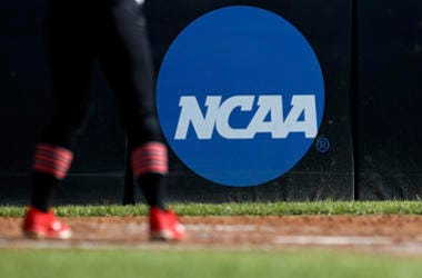 In this April 19, 2019, file photo, an athlete stands near a NCAA logo during a softball game in Beaumont, Texas.
