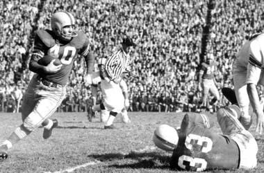 "In this Nov. 1955, file photo, Ohio State halfback Howard ""Hopalong"" Cassady carries the ball against Indiana in Columbus, Ohio."