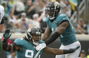 Jacksonville Jaguars defensive end Dawuane Smoot (94) celebrates after sacking New York Jets quarterback Sam Darnold during the first half of an NFL football game, Sunday, Oct. 27, 2019, in Jacksonville, Fla.