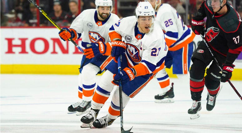 Islanders left wing Anders Lee skates with the puck against the Carolina Hurricanes in Game 4 of their second-round playoff series on May 3, 2019, at PNC Arena in Raleigh, North Carolina.