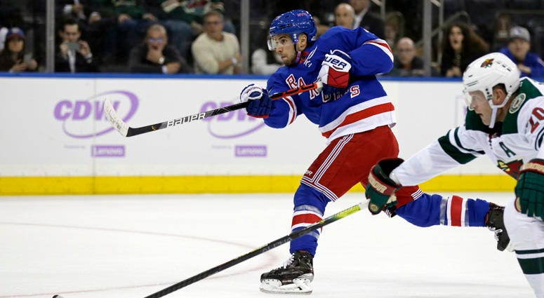 Rangers defenseman Tony DeAngelo shoots and scores the game-winning goal in overtime against the Minnesota Wild on Nov. 25, 2019, at Madison Square Garden.