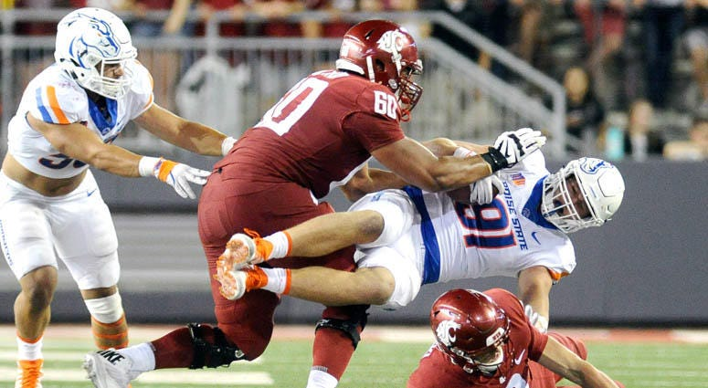 Washington State offensive lineman Andre Dillard (60) takes out Boise State defensive end Durrant Miles on a block on Sept. 7, 2017, at Martin Stadium in Pullman, Washington.