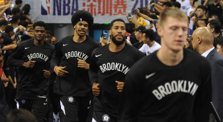 Brooklyn Nets players arrive for a game against the Lakers on Oct. 12, 2019, in Shenzhen, China.
