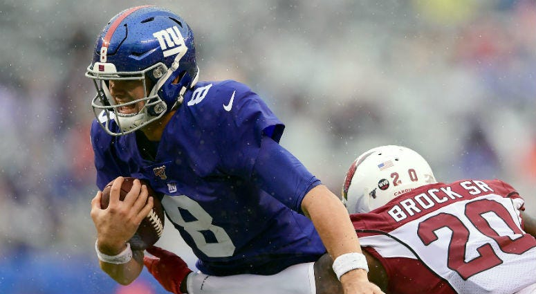 OCTOBER 20: Daniel Jones #8 of the New York Giants runs the ball against Tramaine Brock #20 of the Arizona Cardinals during the second half at MetLife Stadium on October 20, 2019 in East Rutherford, New Jersey.