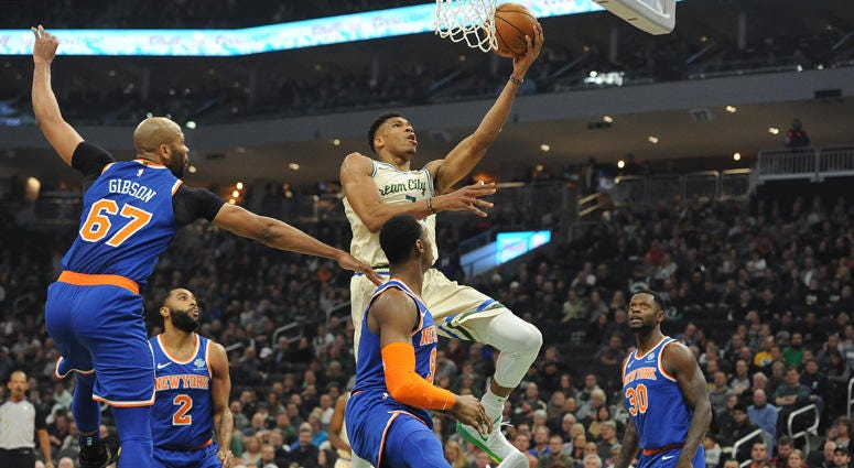 Bucks forward Giannis Antetokounmpo lays up a shot against the Knicks on Dec. 2, 2019, at Fiserv Forum in Milwaukee.