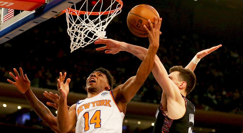 Knicks guard Allonzo Trier goes up for a shot and is fouled by Nets forward Rodions Kurucs on Dec. 8, 2018, at Madison Square Garden.
