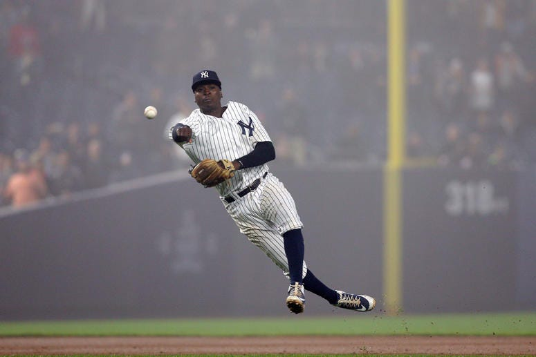 Didi Gregorius throws out Minnesota Twins shortstop Eduardo Escobar for the final out of the game during the ninth inning at Yankee Stadium.