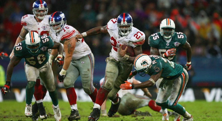The Giants' Brandon Jacobs carries the ball against the Miami Dolphins on Oct. 28, 2007, at Wembley Stadium in London.