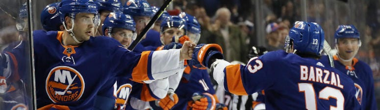 Mathew Barzal of the New York Islanders celebrates his goal at 16:01 of the second period against the Columbus Blue Jackets at the Barclays Center on November 30, 2019 in the Brooklyn borough of New York City