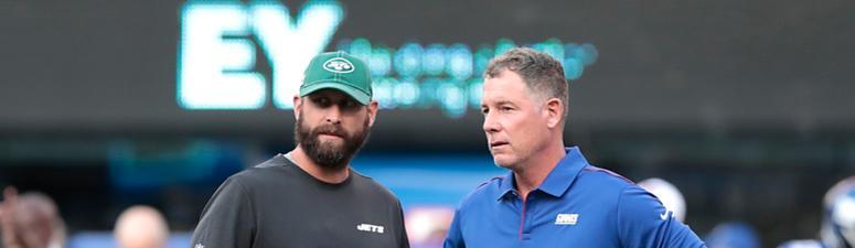 New York Jets head coach Adam Gase talks with New York Giants head coach Pat Shurmur Aug 8, 2019; East Rutherford, NJ