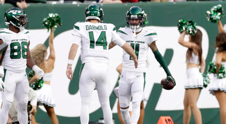 New York Jets quarterback Sam Darnold (14) celebrates a touchdown with Robby Anderson (11) during the first half of an NFL football game against the Dallas Cowboys, Sunday, Oct. 13, 2019, in East Rutherford, N.J.