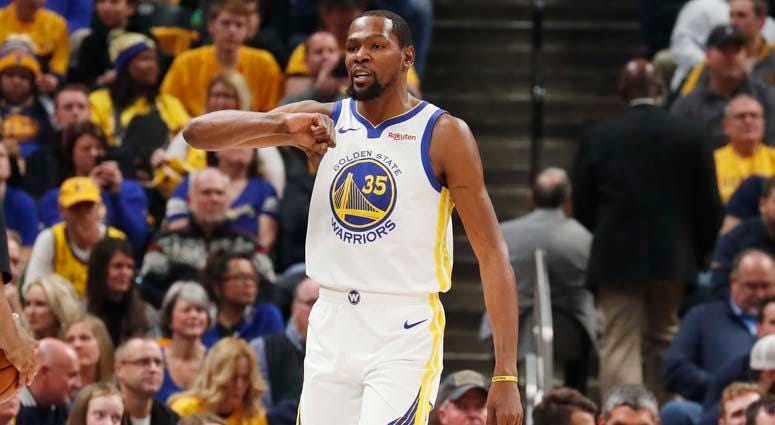 Warriors forward Kevin Durant reacts by pounding on his chest after making a play against the Pacers on Jan. 28, 2019, at Bankers Life Fieldhouse in Indianapolis.