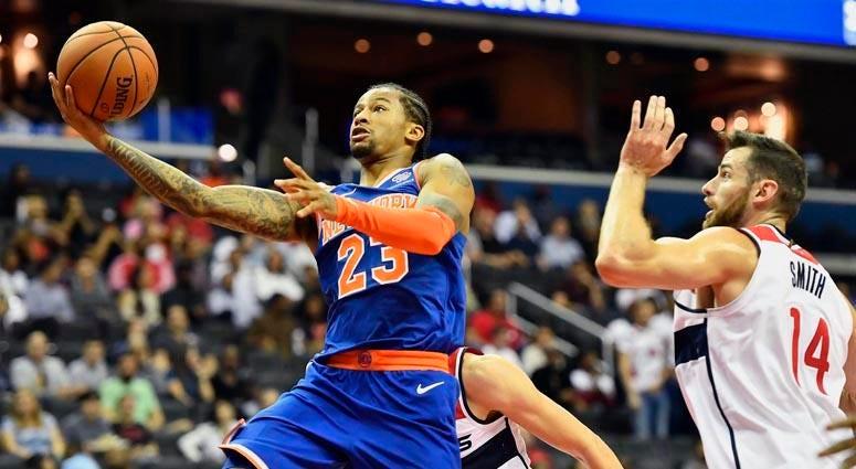 Knicks guard Trey Burke (23) shoots against Wizards forward Jason Smith on Oct. 1, 2018, at Capital One Arena in Washington.