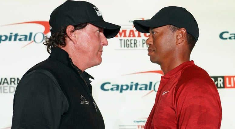 November 20, 2018; Las Vegas, NV, USA; Phil Mickelson (left) and Tiger Woods (right) pose for a photo during a press conference before The Match: Tiger vs Phil golf match at Shadow Creek Golf Course. Mandatory Credit: Kyle Terada-USA TODAY Sports