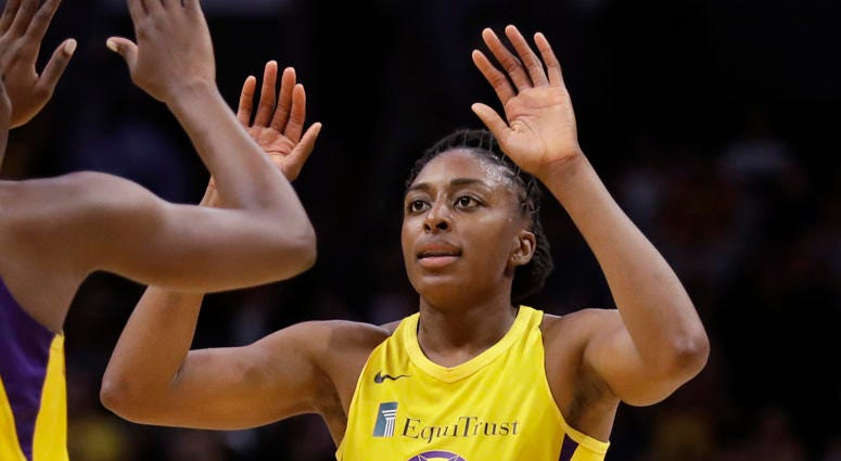 In this May 31, 2019, file photo, the Los Angeles Sparks' Chiney Ogwumike, obscured at left, and her sister Nneka Ogwumike celebrate after a win over the Connecticut Sun in Los Angeles.