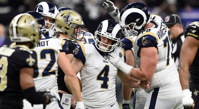 Jan 20, 2019; New Orleans, LA, USA; Los Angeles Rams kicker Greg Zuerlein (4) is congratulated by teammates. Mandatory Credit: John David Mercer-USA TODAY Sports