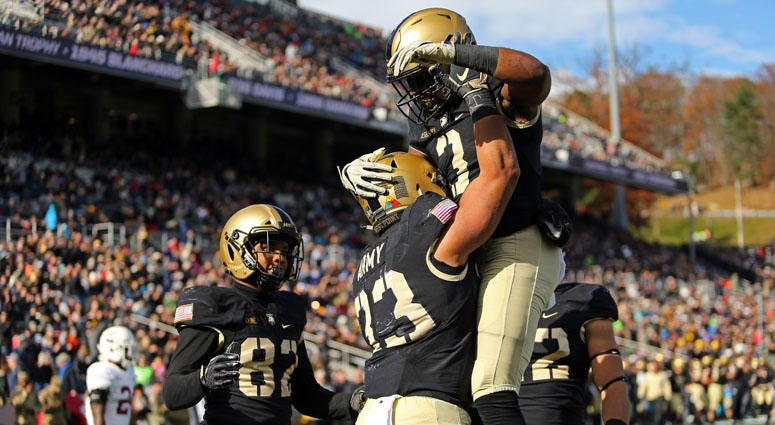 Army Black Knights running back Darnell Woolfolk (33) celebrates a touchdown with running back Jordan Asberry (3) against the Lafayette Leopards on Nov. 10, 2018, at Michie Stadium in West Point, New York.